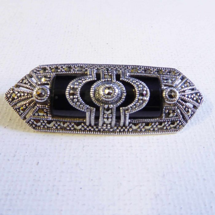Silver, black onyx and marcasite brooch.
