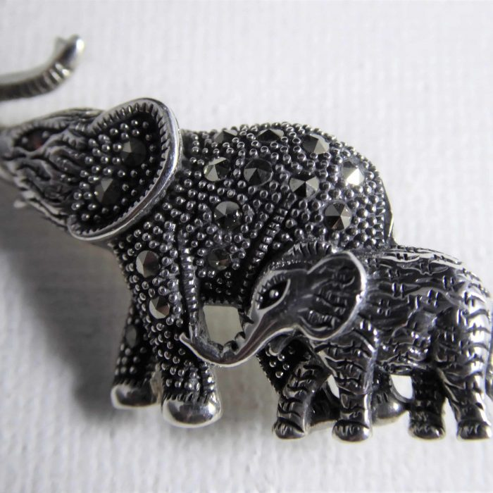Silver marcasite mother and baby elephant brooch.