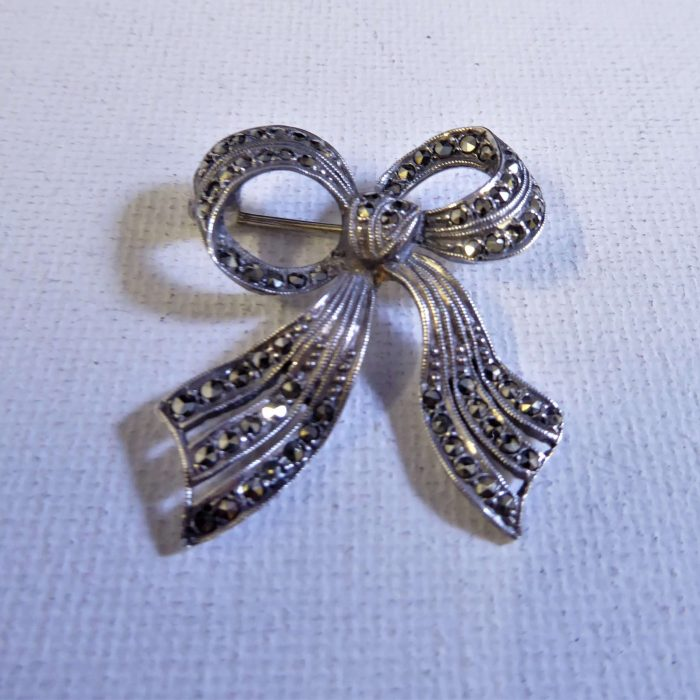 silver and marcasite bow brooch