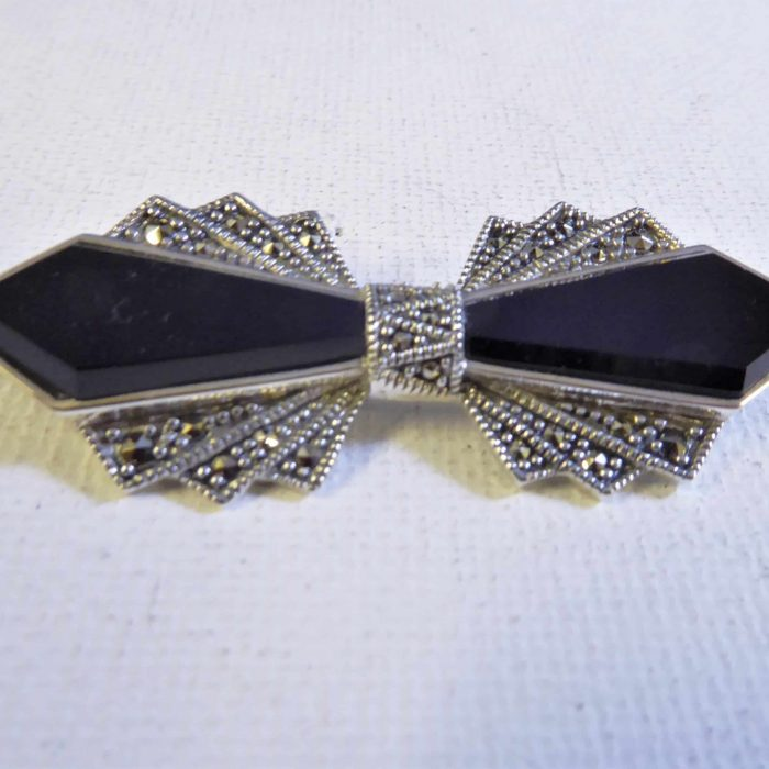 silver, marcasite and onyx bow brooch