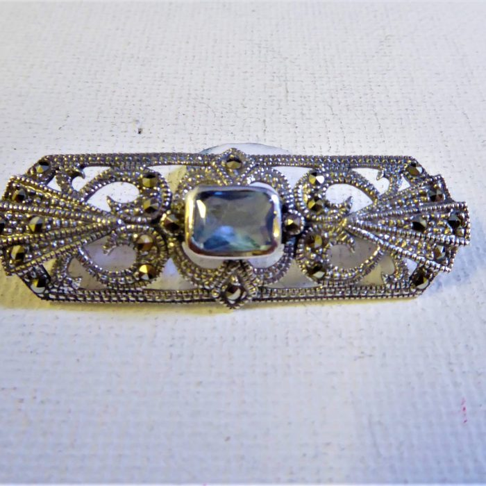 Silver, marcasite and blue topaz brooch