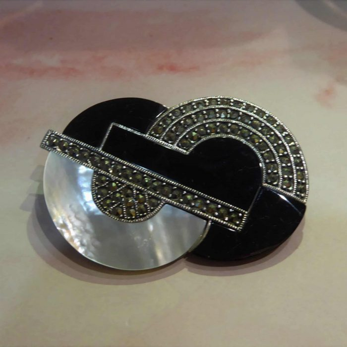 Art Deco style mother of pearl, onyx and marcasite brooch