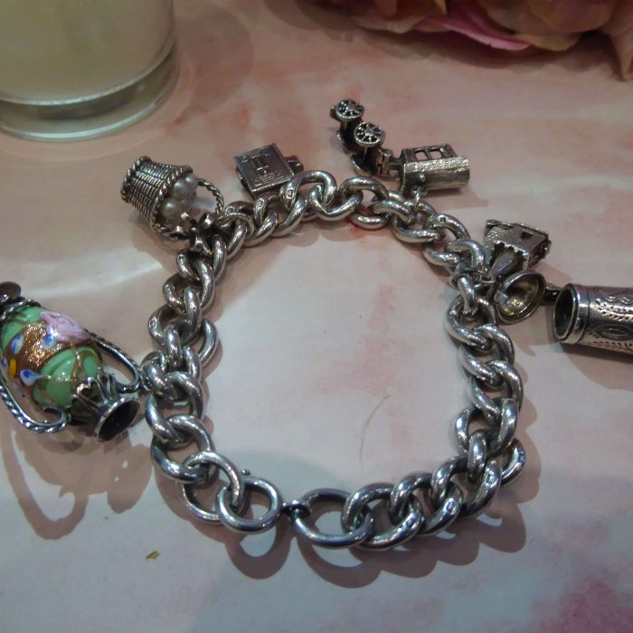 1930s heavy silver charm bracelet with 6 charms